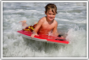 Kid bodyboarding