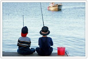 Two kids fishing off the pier