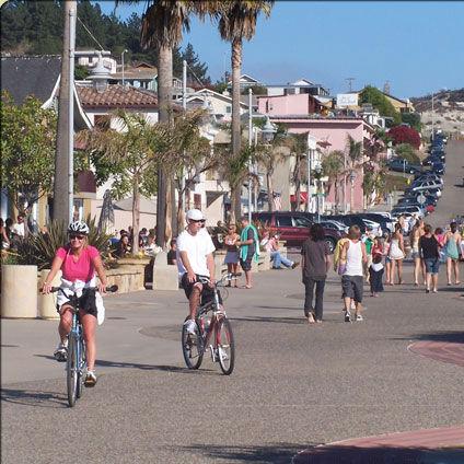 Avila Beach Welcome Sign Kids Body Boarding Biking In Downtown
